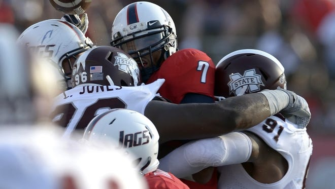 Sep 13, 2014; Mobile, AL, USA; South Alabama Jaguars quarterback Brandon Bridge (7) fumbles the ball as he is hit by Mississippi State Bulldogs defensive lineman Chris Jones (96) and defensive lineman Preston Smith (91) in the third quarter at Ladd-Peebles Stadium. Mississippi State defeated South Alabama, 35-3. Mandatory Credit: Glenn Andrews-USA TODAY Sports
