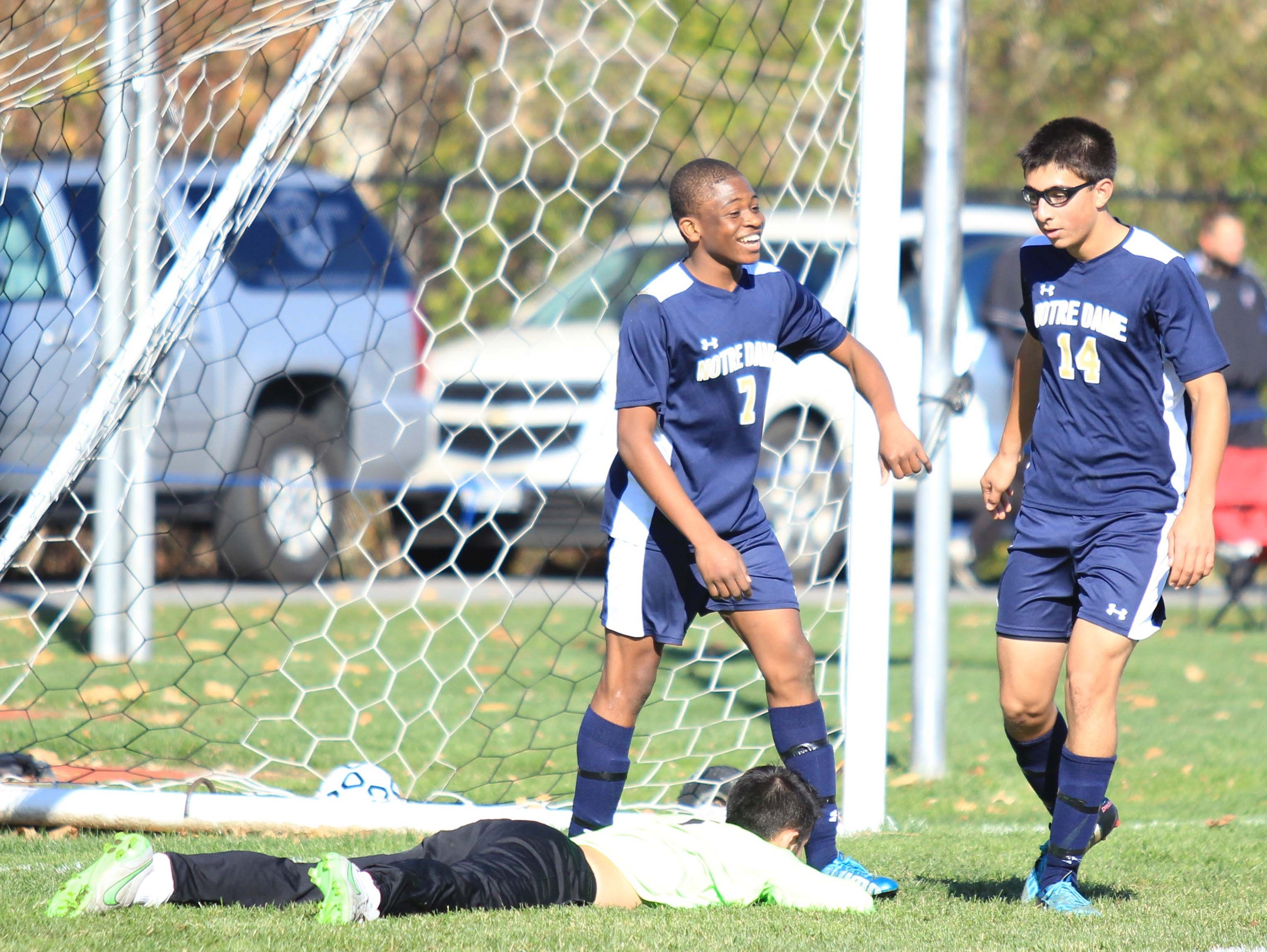 Notre Dame's Rocco Coulibaly (left) and Aidan Sharma (right) celebrate after a goal in the NYSPHSAA Class C final in Middletown.