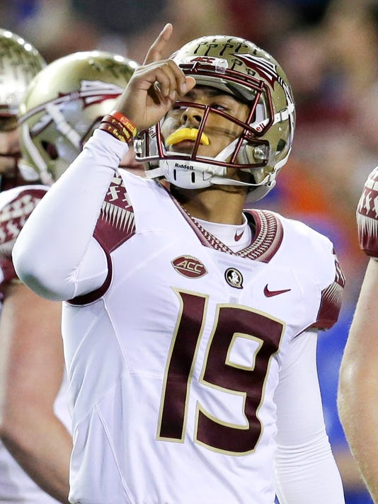 FILE - In this Nov. 28, 2015 file photo, Florida State place kicker Roberto Aguayo (19) points up after kicking a 43-yard field goal against Florida during the first half of an NCAA college football game, in Gainesville, Fla. Aguayo, who is the most accurate kicker in NCAA history, could be the first kicker in 10 years to be selected in the first three rounds of the NFL Draft. (AP Photo/John Raoux, File)