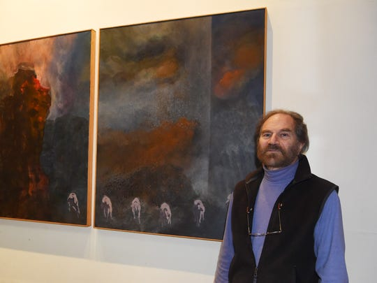 Murray Zimiles, an artist based out of Millerton, stands with a triptych he painted centering around 9/11. The triptych will be displayed in the 9/11 Museum in Manhattan.