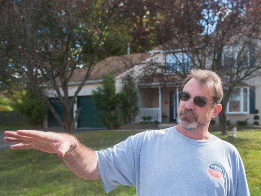 Dave Rosoff, the U.S. Environmental Protection Agency's on-site coordinator, stands in front of a home at 29 Birchly Court in West Deptford. The EPA formally linked this property's contamination to a nearby Superfund site.
