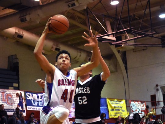 Las Cruces High's Devon Esslinger gets to the rim for