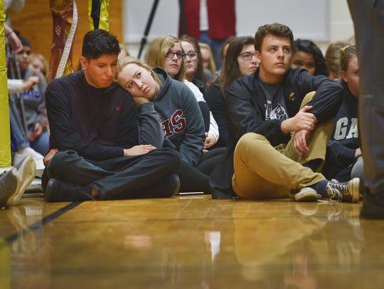 Roosevelt High School student Maddie Kline leans on