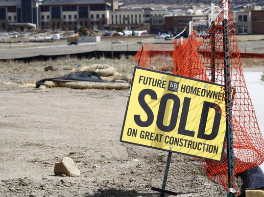 sold sign at construction site