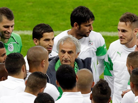 Algeria's head coach Vahid Halilhodzic, center, speaks to players before an official training session the day before the group H World Cup soccer match between South Korea and Algeria at the Estadio Beira-Rio in Porto Alegre, Brazil, Saturday, June 21, 2014.  (AP Photo/Lee Jin-man)