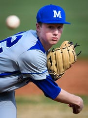 Memorial's Michael Landauer pitches as Memorial plays Reitz at Bosse Field Tuesday, April 4, 2017.