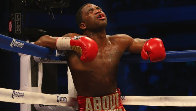 Adrien Broner, shown during his first career loss to Marcos Maidana on Saturday, had assualt charges against him in Ohio dismissed.