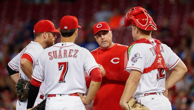 Cincinnati Reds manager Bryan Price, center right, waits on the mound after removing starting pitcher Asher Wojciechowski during the fourth inning.