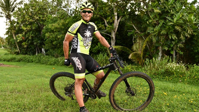Peter Lombard, Guam's mountain bike olympic competitor for this years Olympic Games in Rio, trains at Nimitz Hill on July 19.