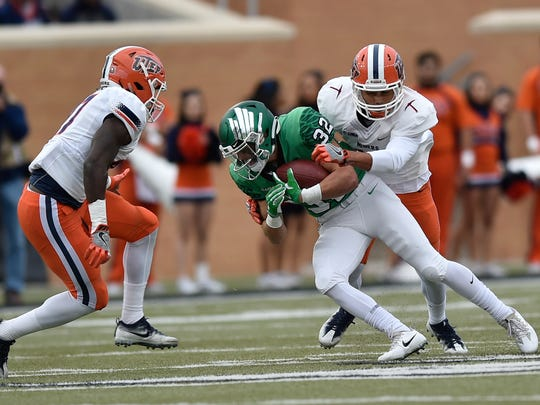 North Texas' Michael Lawrence (32) catches a pass while UTEP defensive back Jerrell Brown, right, tries to tackle him during an NCAA college football game Saturday, Nov. 11, 2017, in Denton.