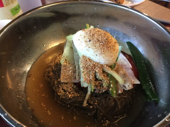 At the new Tofu House Korean restaurant on East Moana Lane in Reno, naengmyon features a snarl of cold arrowroot noodles, beef, pickled vegetables and hard-cooked egg, all bound by a spicy sauce.