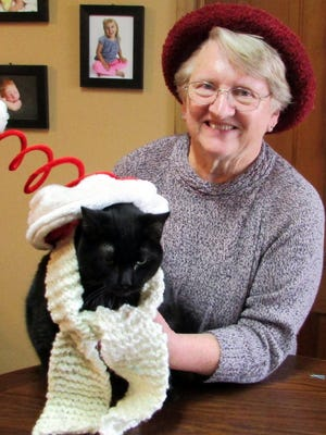Susan Manzke and their Christmas cat, Pete.