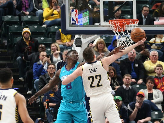 Indiana Pacers forward T.J. Leaf (22) shoots against Charlotte Hornets forward Johnny O'Bryant (8) during the first quarter at Bankers Life Fieldhouse.