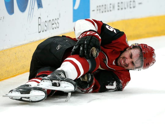 Arizona Coyotes defenseman Kyle Capobianco reacts after