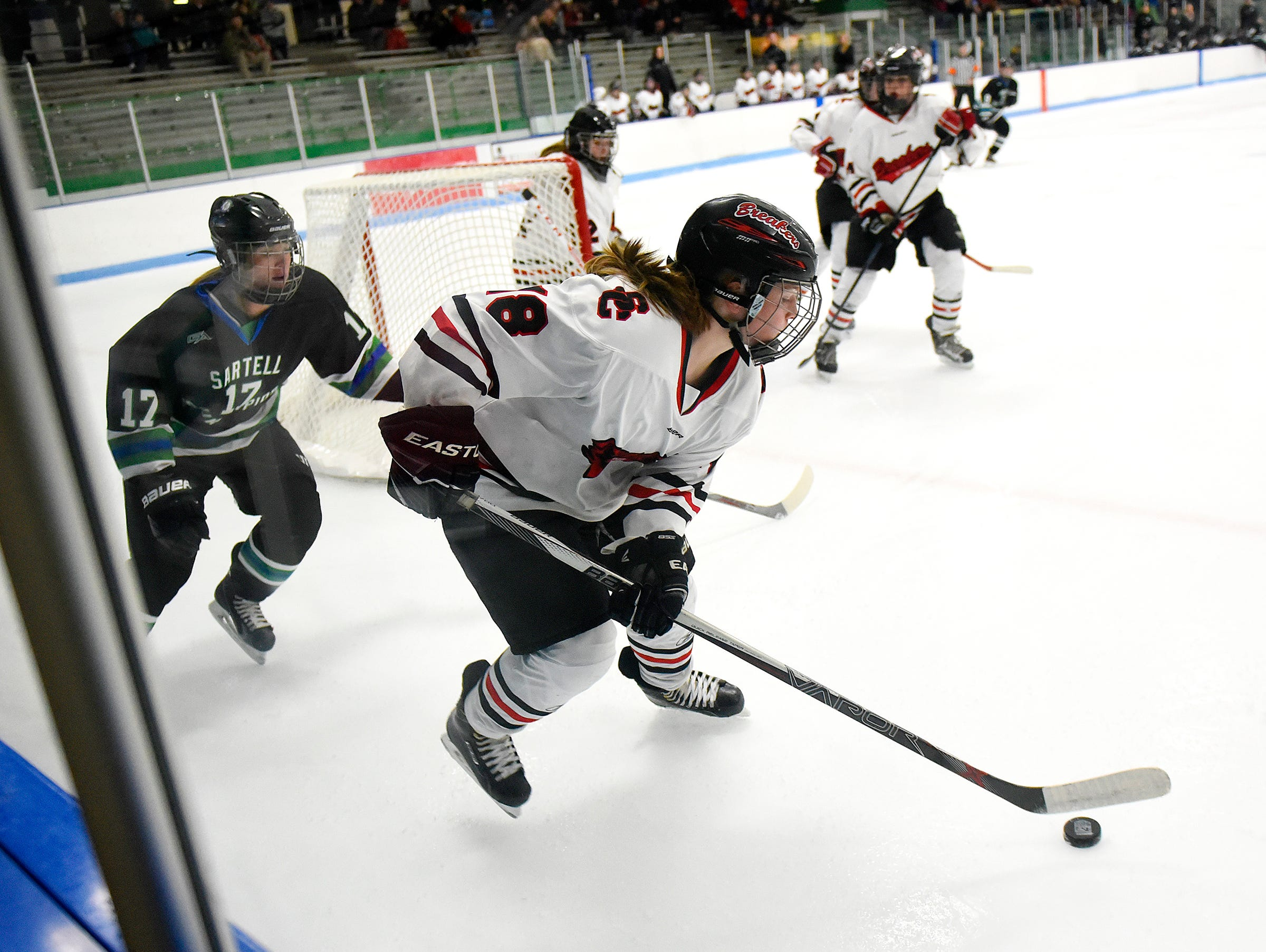 Jordann Swingle of the Icebreakers skates with the puck near the boards during the first period of Thursday's game at the MAC in St. Cloud.