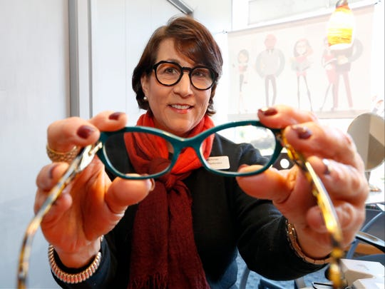 Renee Bachner of Renee's Readers in New City, designs her own line of reading glasses. Wednesday, November 23, 2016.