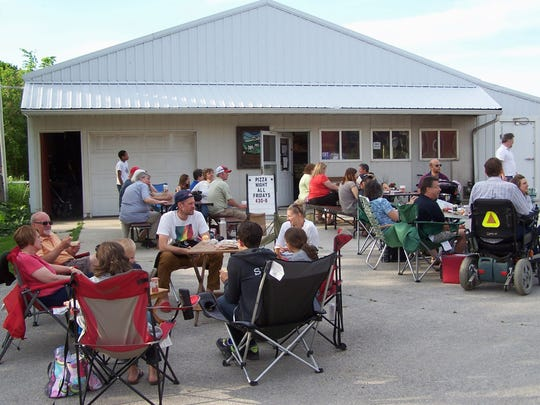 Pizza lovers of all ages gathered on the evening of Friday, June 2 in the yard in front of the organic retail store at the Grassway Organics Farm in southern Calumet County.