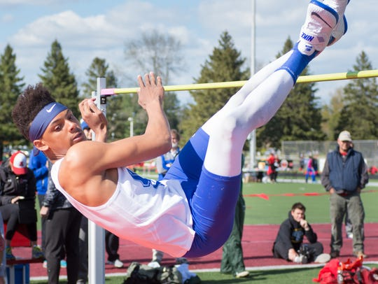 James Carter of Oak Creek (shown in the high jump)