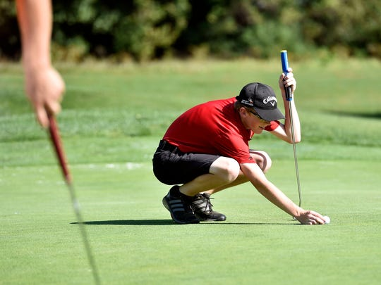 Susquehannock's Andrew Roberts lines up his shot during the YAIAA golf team championship Wednesday, Sept. 27, 2017, at Briarwood Golf Club.