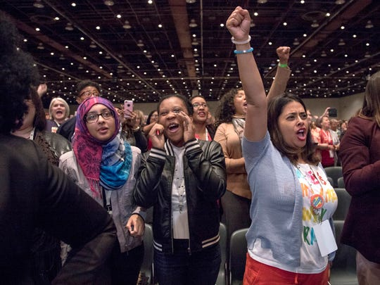 Left to right, Amina Khalique, Tamera Middlebrooks, and Aditi Bagchi cheer as Congresswoman Maxine Waters speaks at the Sojourner Truth Lunch at the Women's Convention at Cobo Center in downtown Detroit, Saturday, October 28, 2017.
