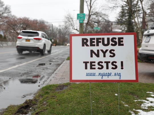 Opt out signs along Webster Ave. in New Rochelle on Tuesday, April 3, 2018.