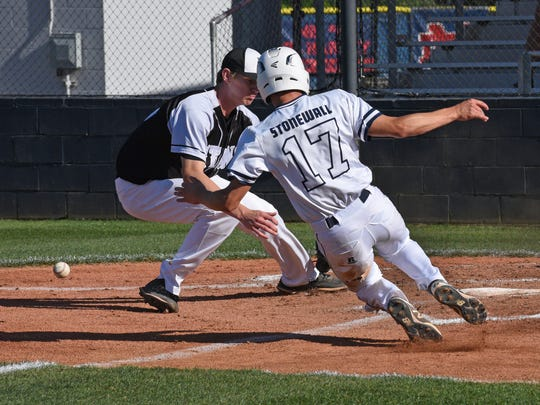 North DeSoto's Carson Curtis is safe at home in their
