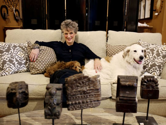 Mary Liz Curtin, owner of Leon & Lulu in Clawson, with her dogs Bertie Wooster and Spot in October 2013.