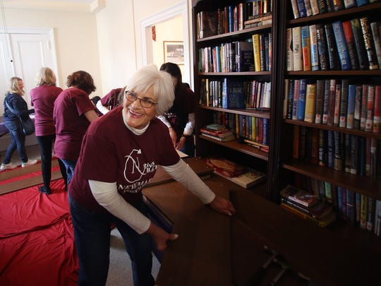 Valentine volunteer Pat Cunningham of Rockaway joins co-workers from from Newmark Associates putting the finishing touches on the $1.5M renovation project that was completed last year at the Mt. Kemble Home, a historic landmark offering affordable housing to senior women in Morristown. February 14, 2017, Morristown, NJ.