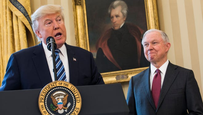 Attorney General Jeff Sessions listens as President Trump speaks in the Oval Office of the White House on Feb. 9, 2017.