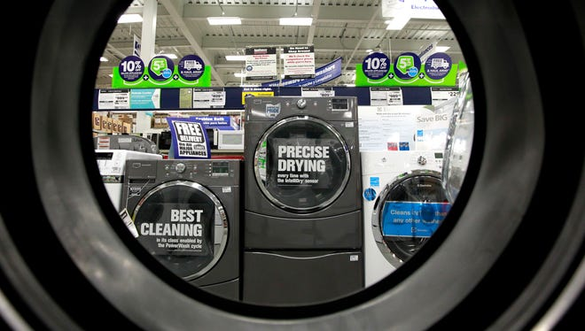 Clothes dryers as seen from the inside of another dryer at a Lowe's store in Framingham, Mass.