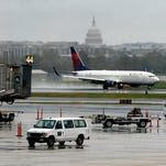 Ia this 2012 file photo, a jet takes off from Ronald Reagan Washington National Airport with the U.S. Capitol in the background.