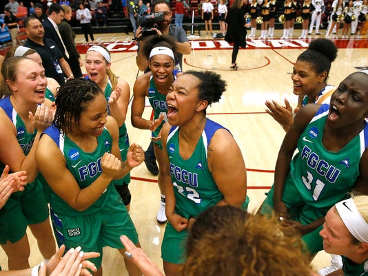 Florida Gulf Coast guard China Dow, center, celebrates with teammates after the team's 80-70 victory against Missouri in a first-round game in the NCAA women's college basketball tournament in Stanford, Calif., Saturday, March 17, 2018. (AP Photo/Tony Avelar)