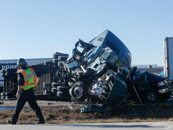 Emergency personnel work the scene of an accident involving