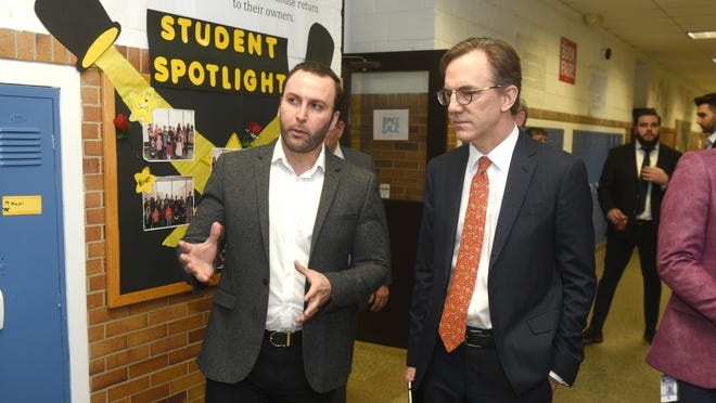 Keys Grace Charter Academy founder Nathan Kalasho, left, speaks with Joseph Pennington, Deputy Assistant Secretary of the United States State Department, while touring the school in Madison Heights on Friday April 28, 2017.