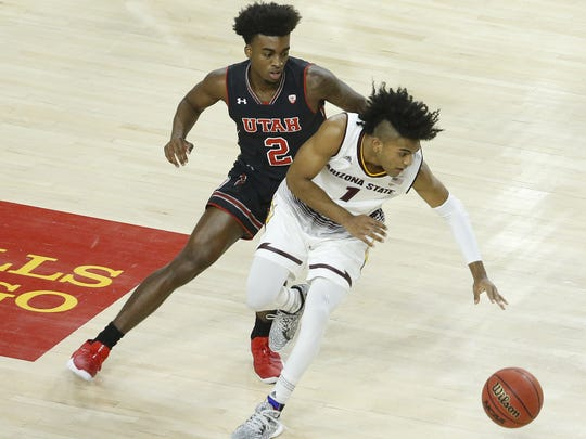 ASU's Remy Martin (1) recovers a loose ball against Utah's Kobe Caldwell (2) during the first half at Wells Fargo Arena on January 25, 2018 in Tempe, Ariz.