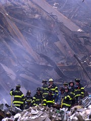 Hundreds of rescue workers continue to work at the scene  around the World Trade Center on Friday morning   .....(Frank Becerra  Jr./ The Journal News 9/14/2001 )