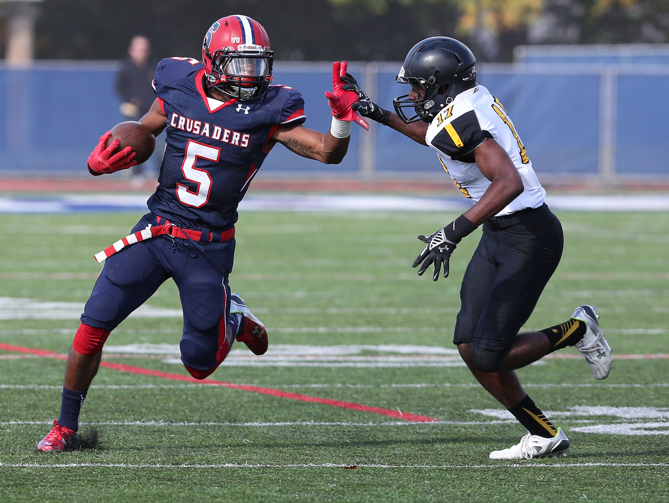 Stepinac's Kobe Miranda (5) tries to get around Saint Anthony's Justin Percival (17) on a first half run during a football game at Stepinac High School in White Plains Oct. 17, 2015. Stepinac won the game 49-32.