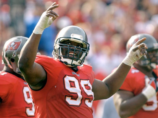 FILE - In this Jan. 12, 2003, file photo, Tampa Bay Buccaneers' Warren Sapp tries to get the crowd going during the third quarter of the NFC divisional NFL football playoff game against the San Francisco 49ers in Tampa, Fla. Sapp is donating his brain for medical research. Sapp announced on social media Tuesday, June 20, 2017, that his brain will go to the Concussion Legacy Foundation after his death. The 44-year-old said in a statement that he's started to feel the effects of the many hits he took during his 13-year NFL career. He said he's specifically become concerned about his memory. Sapp said he hopes his donation can help prevent concussions and permanent brain damage for future football players. (AP Photo/Steve Nesius, File)