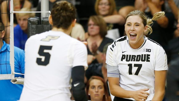 Blake Mohler, right, and Ashley Evans celebrate a Purdue