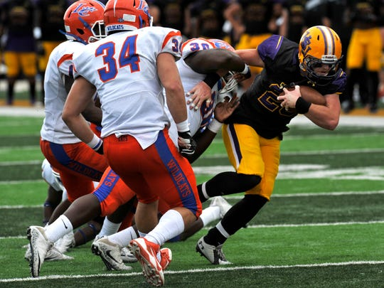 Hardin-Simmons University running back Eli Peterson breaks a Louisiana College tackle during Saturday's game at Shelton Stadium Sept. 16, 2017.