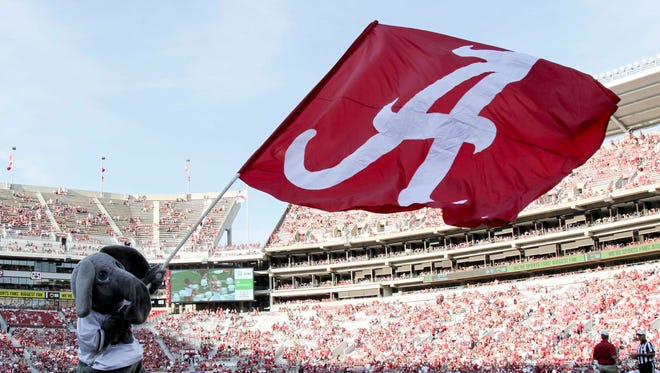 Alabama mascot Big AL waves a flag during a game against Western Kentucky at Bryant-Denny Stadium.