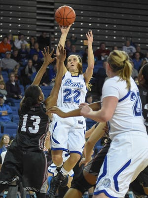 Drake's Caitlin Ingle (22) pulls up for a jump shot against Southern Illinois Rishonda Napier (13) during the first half at the Knapp Center on Jan. 11.