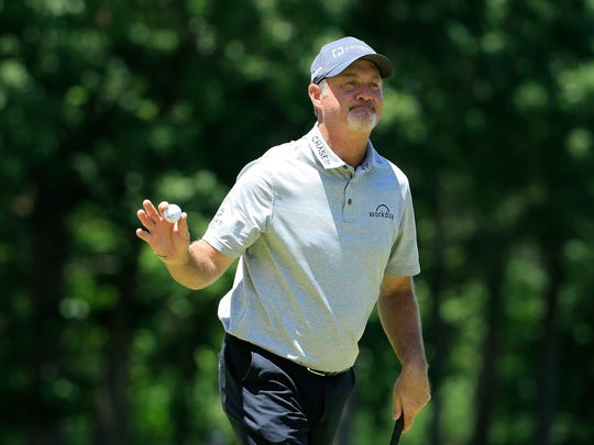 Jerry Kelly acknowledges the gallery on the 14th green during the first round of the American Family Insurance Championship.
