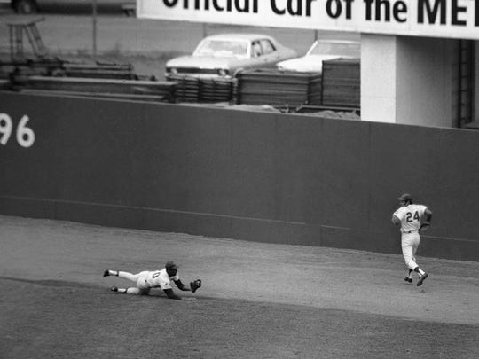 Mets center fielder Tommy Agee is diving and clutching Paul Blair's bid for a bases loaded hit in the third game of the World Series on Oct. 14, 1969.