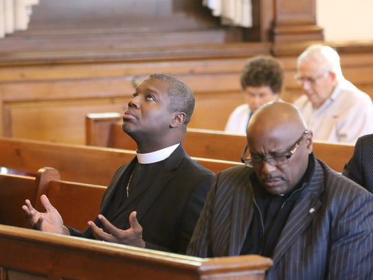George Maize IV, left, pastor of Trinity Baptist Church