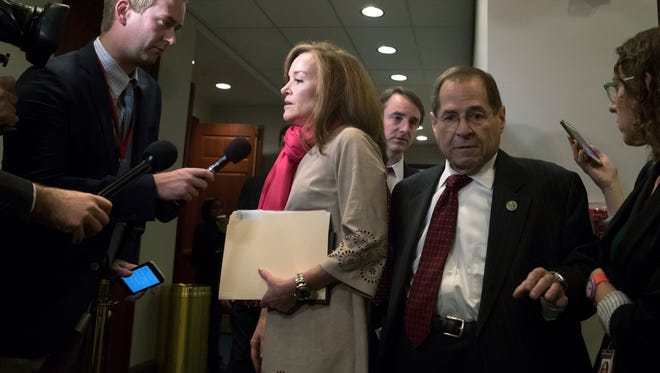 Reporters pose questions to Rep. Kathleen Rice, D-N.Y., center, in the wake of reports of sexual misconduct by Rep. John Conyers, D-Mich., on Wednesday.