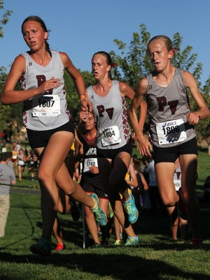 Pine View cross country runners Rylee Holt, Caroline Clements and Jessica Hill, from left, compete in the Region 9 Cross Country race at Bloomington Hills North Park in St. George Tuesday, Oct. 11, 2016. The Pine View High School girls team edged out Desert Hills by 5 points to win the Region 9 Championship Tuesday.