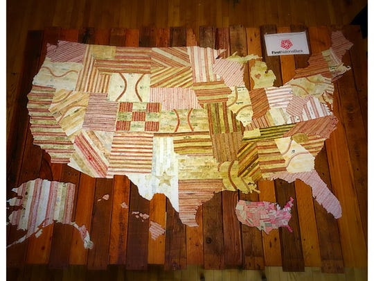 This map was created out of old baseballs by artist