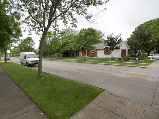 An Appleton police officer and a man who stopped to help the officer were shot Saturday during a struggle with a suspect on the city's east side. A witness said the suspect died after shooting himself in a driveway.