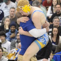 Buena's Mason Brestle jumps into the arms of his coach after defeating West Deptford's Griffin Bonner during Saturday's Region 8 finals at EHT.